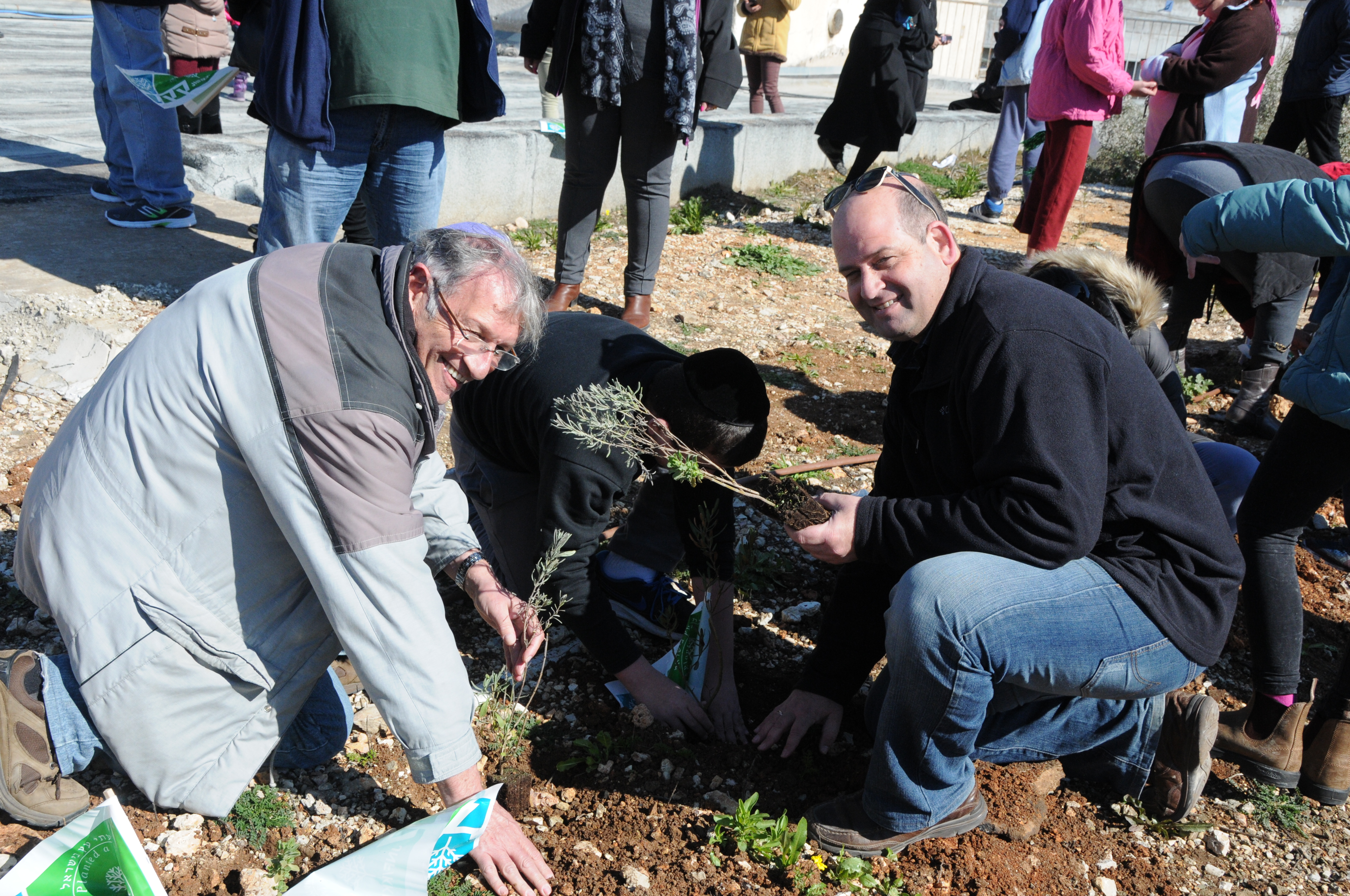 The Hagihon Director, Mr. Zohar Yinon in tree planting activity with children